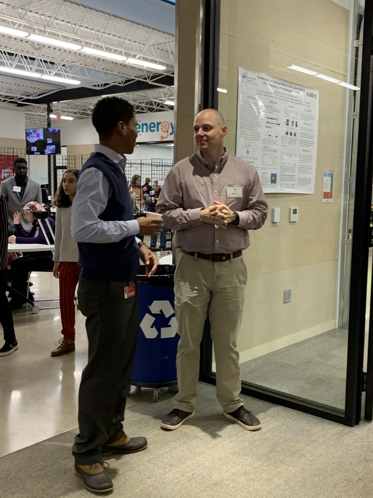 OSU veterinarians, Raphael Marbrue and Eric Miller, catch up during the open house.