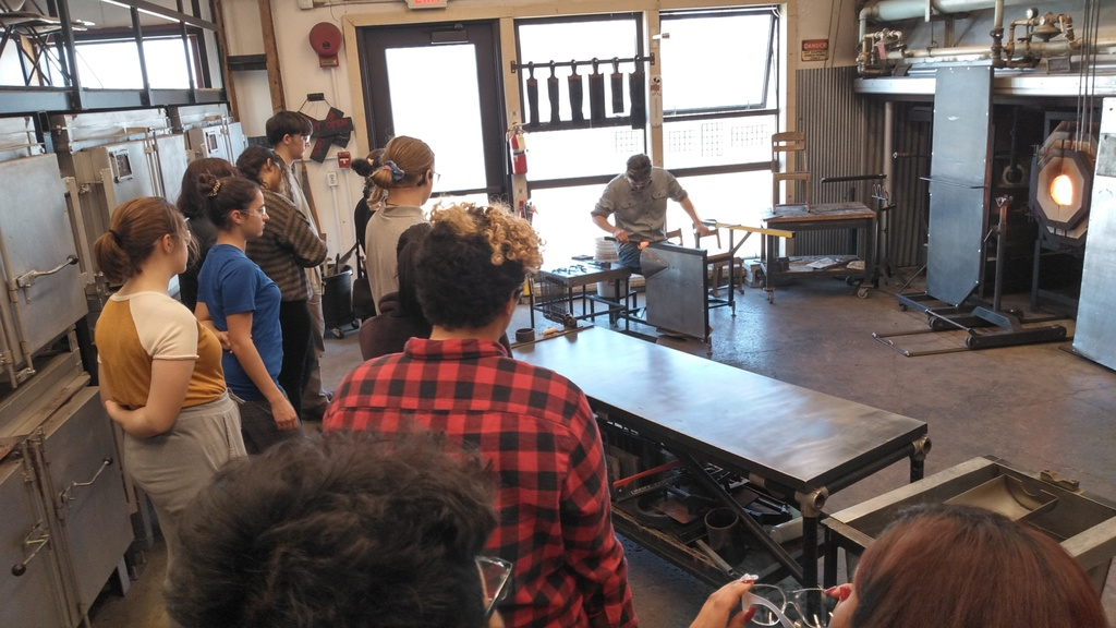 Students viewing glassblowing demonstration