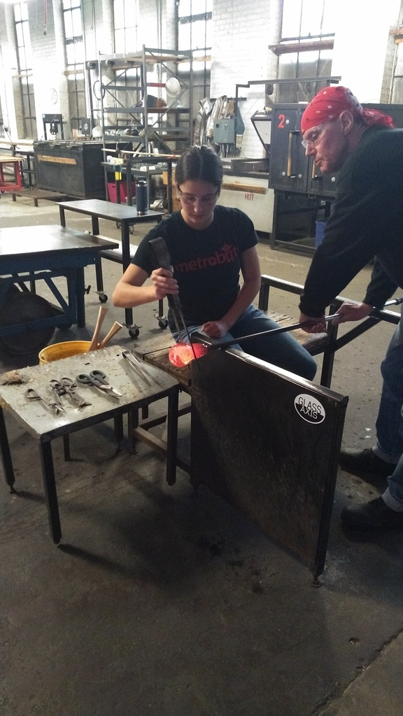 Student using jacks to shape the glass
