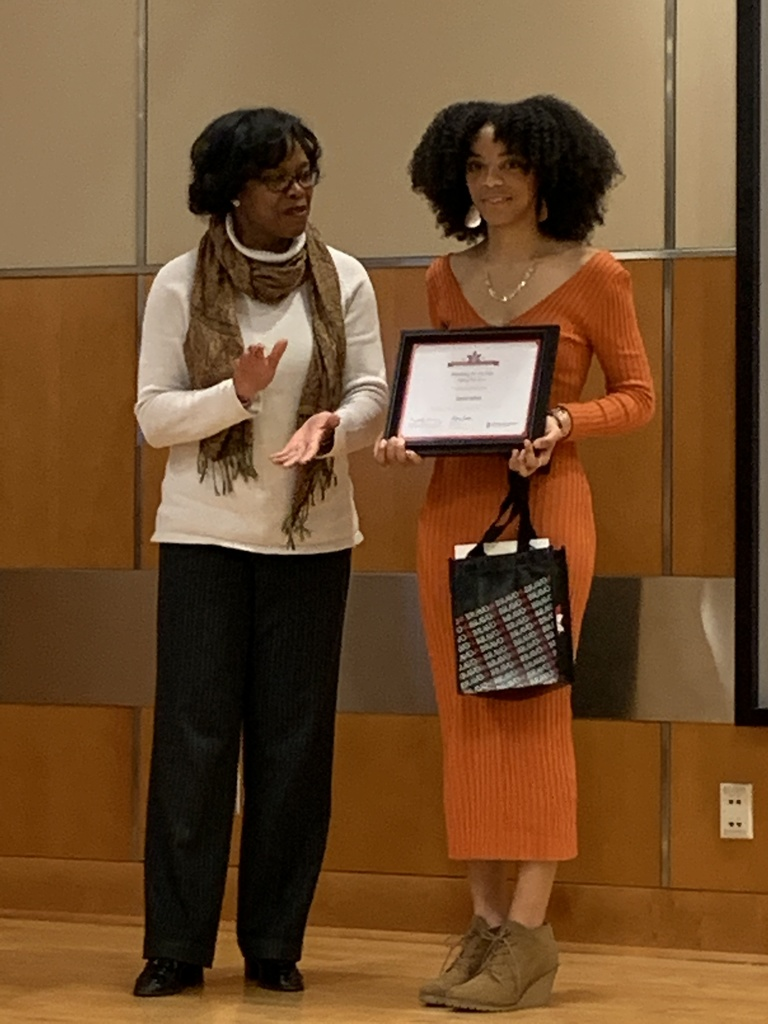 Dr. Cheryl Lee presents a certificate to Sarah White.